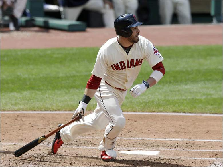 Cleveland Indians' Jason Kipnis hits an RBI-single off Baltimore Orioles starting pitcher Kevin Gausman in the fourth inning.