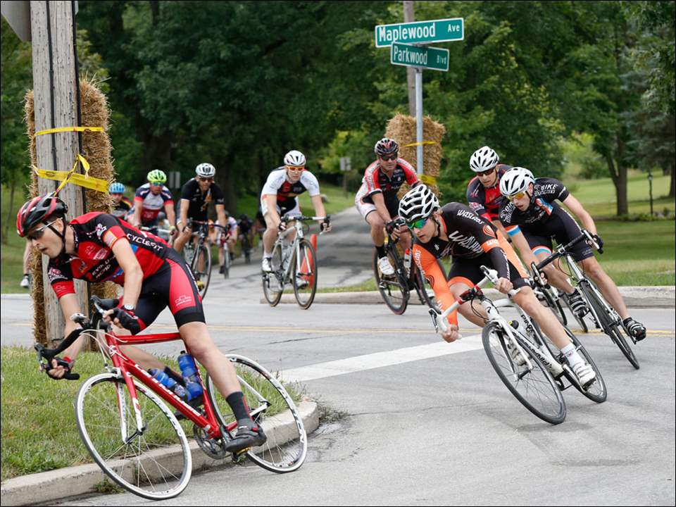 Men's category 3 riders come up Parkwood and lean onto Erie during the race.