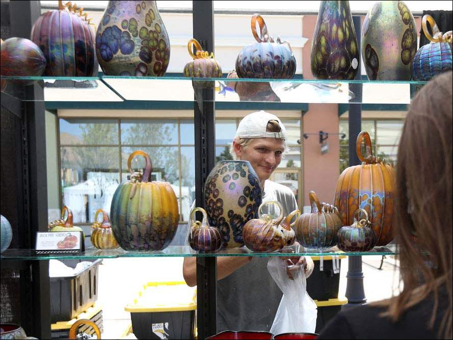 Vendor Jon Zap, who is originally from Ottawa Hills, mans his booth, which features glass pumpkins.