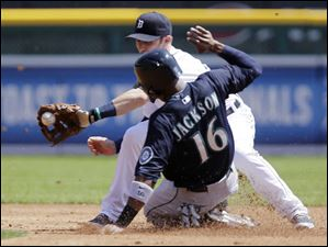 Seattle Mariners' Austin Jackson beats the throw to Detroit Tigers shortstop Andrew Romine to steal second base.