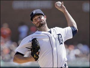 Detroit Tigers pitcher Robbie Ray delivers against the Seattle Mariners.