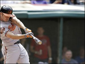 Baltimore Orioles' J.J. Hardy hits an RBI-single off Cleveland Indians relief pitcher Scott Atchison.