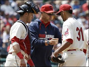 Cleveland Indians starting pitcher Danny Salazar, right, hands the ball off to manager Terry Francona, center.