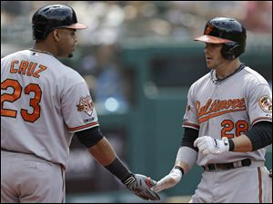 Baltimore Orioles' Steve Pearce, right, is congratulated by Nelson Cruz after Pearce hit a solo home run off Cleveland Indians' Chen-Chang Lee.
