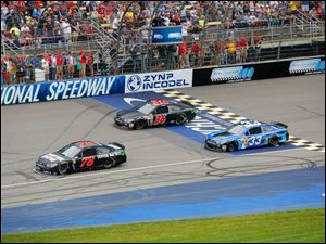 The race begins during the The Pure Michigan 400 at Michigan International Speedway on August 17, 2014.