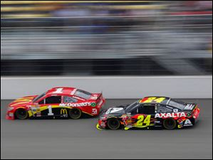 Jeff Gordon takes over Jamie McMurray during the 45th Annual Pure Michigan 400 at Michigan International Speedway on August 17, 2014.