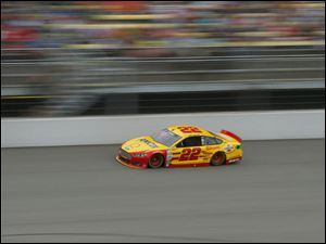 Joey Logano speeds along the track  before losing his lead.
