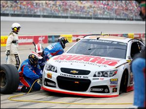 Dale Earnhardt Jr. is in for a pit stop during the 45th Annual Pure Michigan 400.
