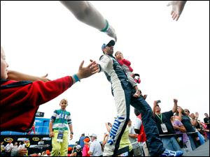 Jimmie Johnson shakes fans hands during driving introductions at The Pure Michigan 400.