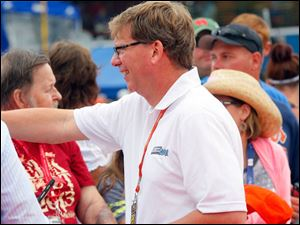 Roger Curtis, president of Michigan International Speedway, greats fans during The Pure Michigan 400.