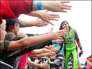 Danica Patrick shakes fans hands during driving introductions at The Pure Michigan 400