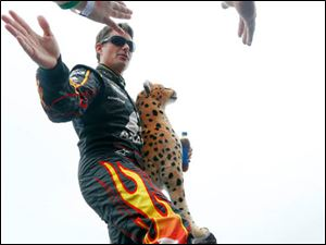 Jeff Gordon holds a stuffed Cheetah for setting the record for the fastest lap at MIS during The Pure Michigan 400.