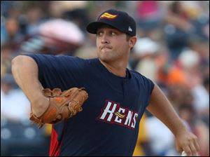 The Mud Hens' Mike Belfiore winds up during the top of the first inning.
