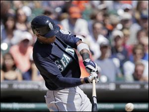 Seattle Mariners' Austin Jackson singles against the Detroit Tigers.