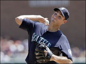 Seattle Mariners' Chris Young pitches against the Detroit Tigers.