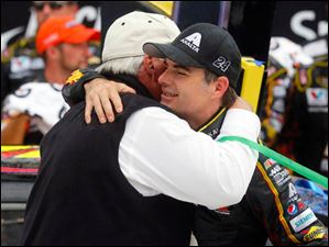 Rick Hendrick, from Hendrick Motorsports, hugs driver Jeff Gordon after Gordon won the 45th Annual Pure Michigan 400 at Michigan International Speedway.