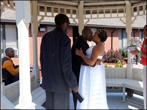 Groom Mark Davis kisses his bride Miriam Reeves after the ceremony.
