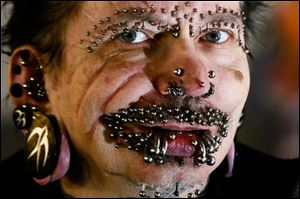 German Rolf Buchholz was refused entry to the Gulf city because of security concerns. The German man now has 453 piercings, including many in his face and genitals, according to Guinness World Records.