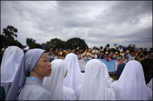 Nuns wait for Pope Francis before a closing Holy Mass of the 6th Asian Youth Day on Sunday in Haemi, South Korea.
