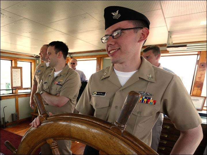 EM1 Joel Danner and his USS Toledo shipmates tour the wheel house of the Col. James Schoonmaker ship in Toledo.