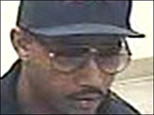 Police are looking for this man in a robbery of a Fifth Third Bank inside a Kroger in Toledo.