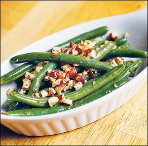 Green beans with crushed almonds.