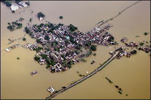 Houses in a residential area are partially submerged by monsoon floods at Nalanda district of Bihar, India, Sunday.