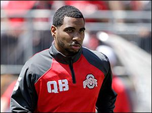 Ohio State quarterback Braxton Miller will miss the 2014 season after reinjuring his shoulder on Monday. OSU hands the reins to red-shirt freshman J.T. Barrett.