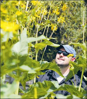 Michael Horst in his backyard garden in Toledo.