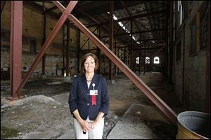 Robin Whitney, vice president of property acquisition and development for ProMedica, inside the former steam plant in downtown Toledo, where ProMedica has announced plans to relocate its headquarters.