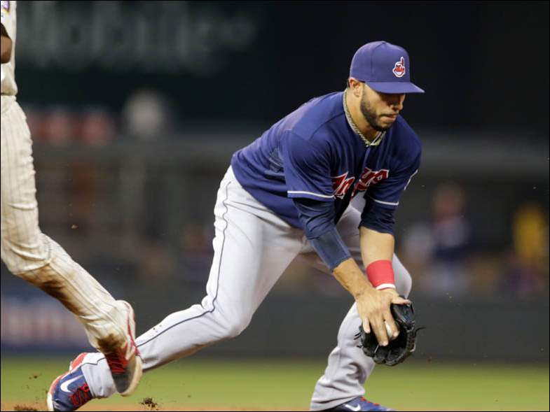 Cleveland Indians shortstop Mike Aviles fields a grounder by Minnesota Twins first baseman Kennys Vargas.