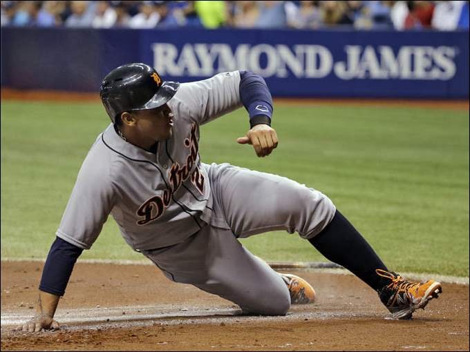 Detroit Tigers' Miguel Cabrera scores on a double by teammate Victor Martinez off Tampa Bay Rays starting pitcher Jake Odorizzi.