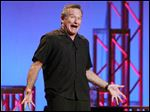 "This Nov. 23, 2009 photo released by Starpix shows actor-comedian Robin Williams performing his stand-up show, ""Weapons of Self Destruction,"" at Town Hall in New York."