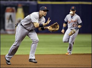 Detroit Tigers third baseman Nick Castellanos fields a ground ball by Tampa Bay Rays' Evan Longoria.