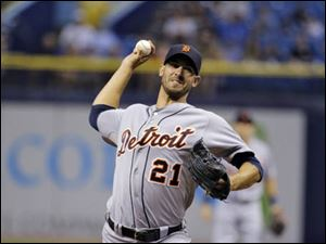 Detroit Tigers starting pitcher Rick Porcello delivers to the Tampa Bay Rays.