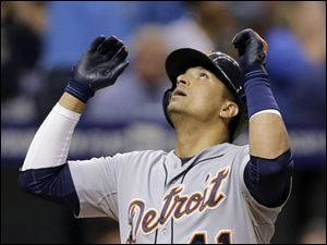 Detroit Tigers' Victor Martinez reacts as he crosses home plate after his grand slam.