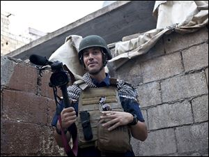American journalist James Foley while covering the civil war in Aleppo, Syria, in November, 2012. He disappeared Nov. 22, 2012 and was shown being beheaded in an ISIS video released Tuesday.