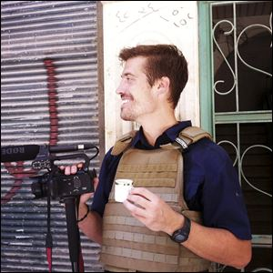Journalist James Foley in Aleppo, Syria, in July, 2012. In a horrifying act of revenge for U.S. airstrikes in northern Iraq, militants with the Islamic State extremist group have beheaded Foley — and are threatening to kill another hostage, U.S. officials say.