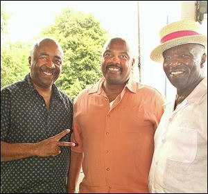 Charles Love, Wilbert McCormick, and Jerome McCormick attend the Detroit Princess Riverboat Cruise fund-raiser.