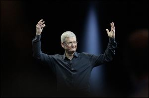 Apple CEO Tim Cook gestures during the Apple Worldwide Developers Conference in San Francisco in June.