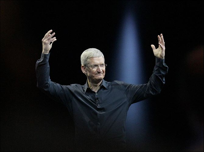 Apple Stock Apple CEO Tim Cook gestures during the Apple Worldwide Developers Conference in San Francisco in June.