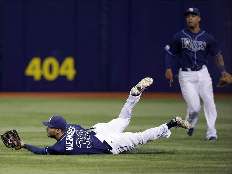 Tampa Bay Rays right fielder Kevin Kiermaier makes a diving catch on a fly ball by Detroit Tigers' Rajai Davis.