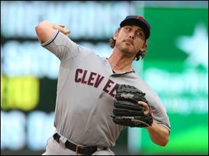 Cleveland Indians starting pitcher Josh Tomlin throws against the Minnesota Twins.