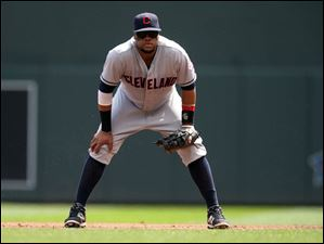 Cleveland Indians first baseman Carlos Santana plays his position.