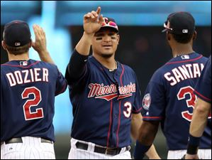 Minnesota Twins right fielder Oswaldo Arcia, center, celebrates with teammates after they defeated the Cleveland Indians.