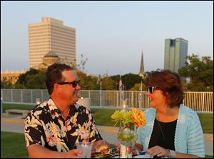 Joe and Brenda Cousino enjoy the Rooftop Bash at the Toledo-Lucas County Public Library Main Branch.