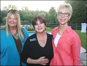Nancy Miller, left, Karen DeNune, center, and Judge Linda Jennings, right, attended the University of Toledo's Women and Philanthropy event at the home of Allan and Susan Block.