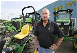 Darrel Ott, grandson of Fred Ott and one of the current owners, said even though his busy season is typically after tge harvest, he's noticed more measured spending. '‍You never know until they get their yields, but the prices are down and it's definitely going to affect [farmers'] buying decisions,' Mr. Ott said.