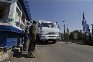 The first trucks in a Russian aid convoy crossed into eastern Ukraine today, seemingly without Kiev's approval.
