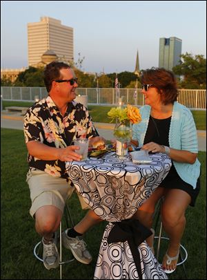 Joe and Brenda Cousino enjoy the Rooftop Bash on Aug. 9 at the Toledo-Lucas County Public Library Main Branch.